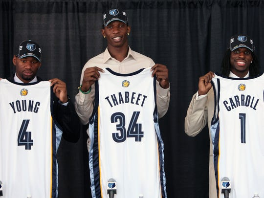 Grizzlies draft picks, from left, Sam Young, Hasheem Thabeet and DeMarre Carroll hold up their new team jerseys at a press conference on June 26, 2009. With the No. 2 pick in the draft, the Grizzlies took Connecticut center Thabeet. At No. 27, they added Carroll and, at No. 36, Young.