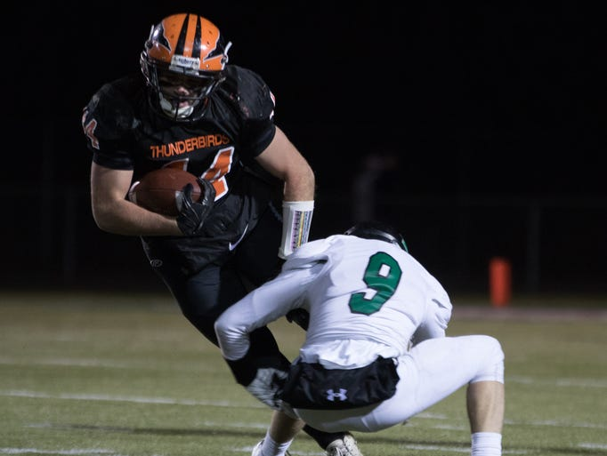 Iola-Scandinavia's Bryce Huetter tries to avoid the
