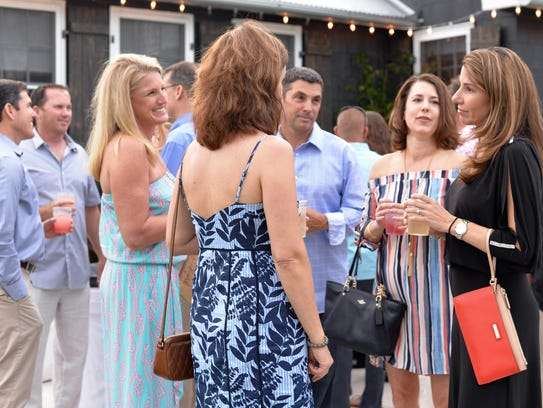"""Attendees enjoy the 2017 """"Evening on the River"""" gala to benefit the Environmental Studies Council and Environmental Studies Center."""