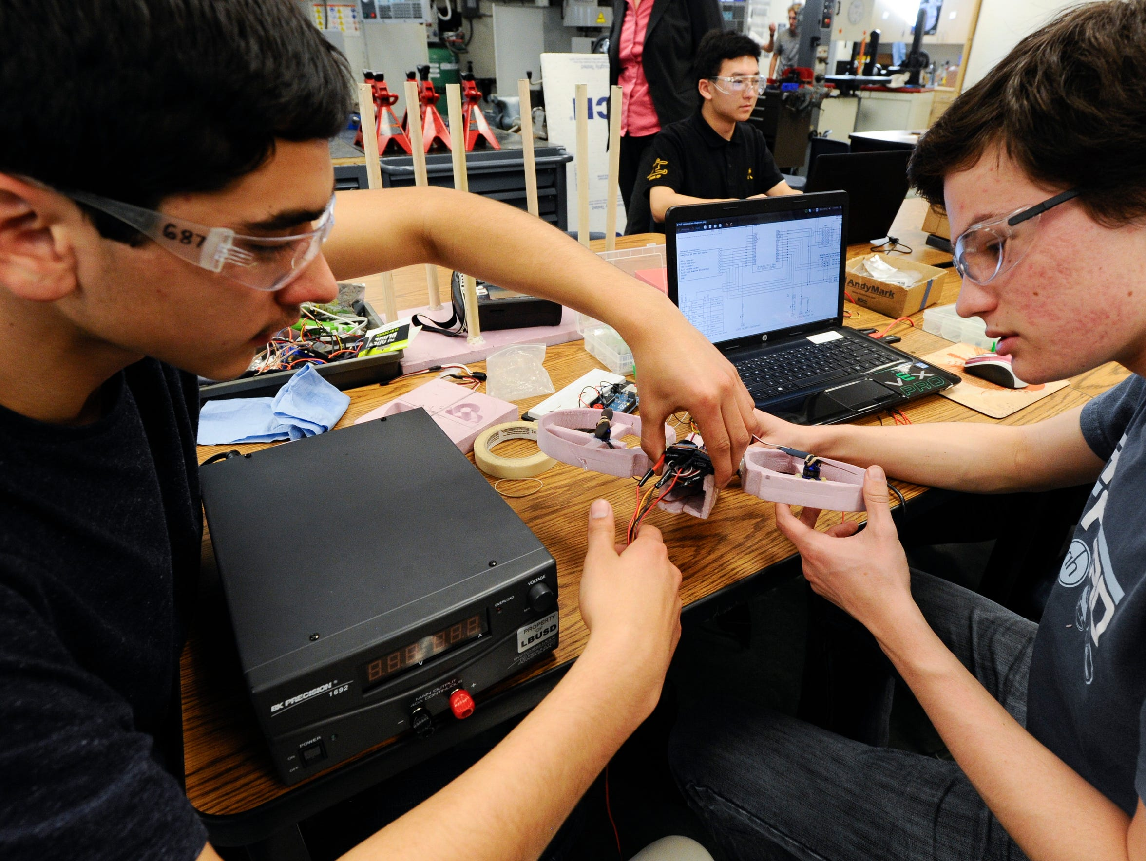 Isaiah Stanley (left) and Dietrich Henson work on assembling