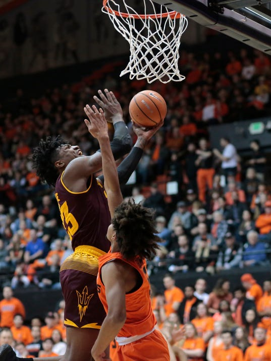 Arizona State's Romello White, rear, goes to the basket while guarded by Oregon State's Ethan Thompson, front. in the first half of an NCAA college basketball game in Corvallis, Ore., Saturday, Feb. 24, 2018. (AP Photo/Timothy J. Gonzalez)