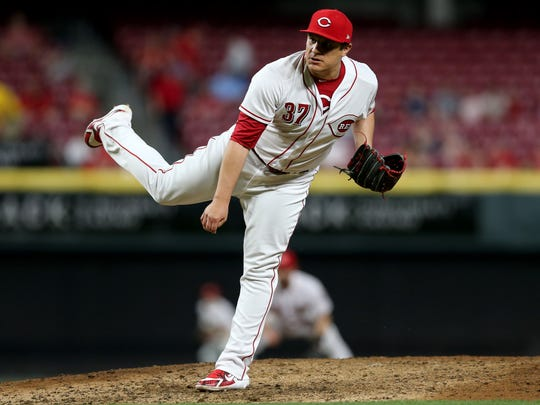Cincinnati Reds relief pitcher David Hernandez (37) follows through on a pitch in the seventh inning during a National League baseball game between the New York Mets and the Cincinnati Reds, Tuesday, May 8, 2018, at Great American Ball Park in Cincinnati. Cincinnati won 7-2.
