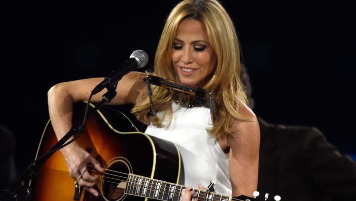 Singer Sheryl Crow performs onstage at the 25th anniversary