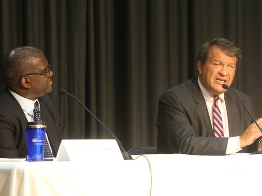 From left, Ken Jenkins and George Latimer debate for County Executive during a candidates forum by the League of Women Voters at Chappaqua Library on Sept. 5, 2017.