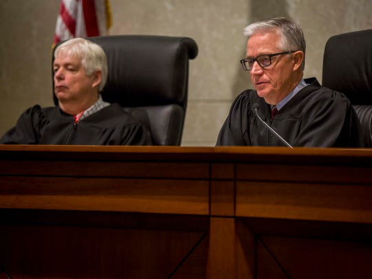Justice David Wiggins and Chief Justice Mark S. Cady, right, ask questions of the lawyers during oral arguments on the Planned Parenthood v. Reynolds case at the Iowa Supreme Court Wednesday, Feb. 14, 2018, in Des Moines, Iowa.
