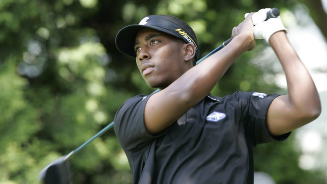 Kevin Hall watches his tee shot on the 10th hole during a past U.S. Open Qualifier held at Maketewah Country Club.