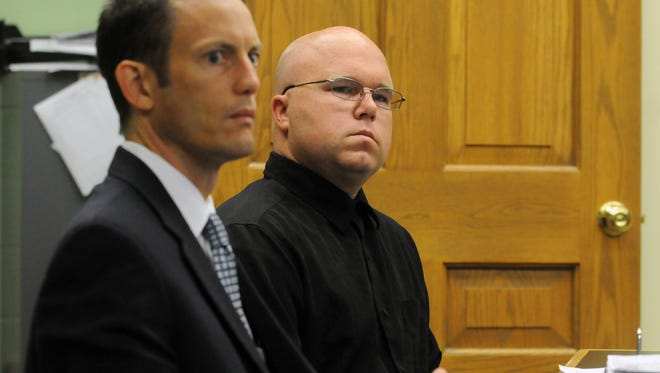 Christopher Bayer, right, listens to Fairfield County Chief Assistant Prosecuting Attorney Darren Meade during Bayer's arraignment Tuesday morning in Fairfield County Common Pleas Court.