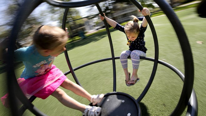Smoking would be banned within 20 feet of playground equipment at Appleton parks, including this merry-go-round at City Park, under a proposal that will be considered by the Appleton Common Council on July 18. Danny Damiani/USA TODAY NETWORK-Wisconsin