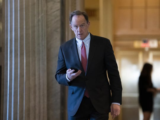 Sen. Pat Toomey, R-Pa., returns from a break in the impeachment trial of President Donald Trump on charges of abuse of power and obstruction of Congress, at the Capitol in Washington, Monday, Feb. 3, 2020. (AP Photo/J. Scott Applewhite)