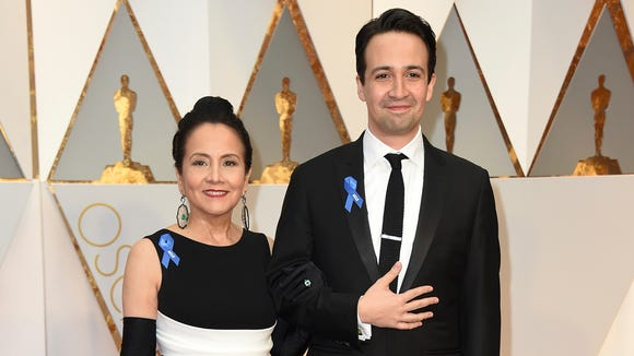 Luz Towns-Miranda, left, and Lin-Manuel Miranda arrive