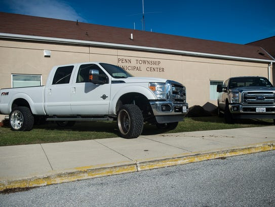 The two vehicles parked in front of the Penn Township