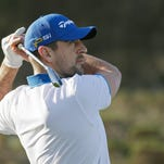 Green Bay Packers quarterback Aaron Rodgers follow his shot from the third tee of the Spyglass Hill Golf Course during the first round of the AT&T Pebble Beach National Pro-Am golf tournament Thursday.