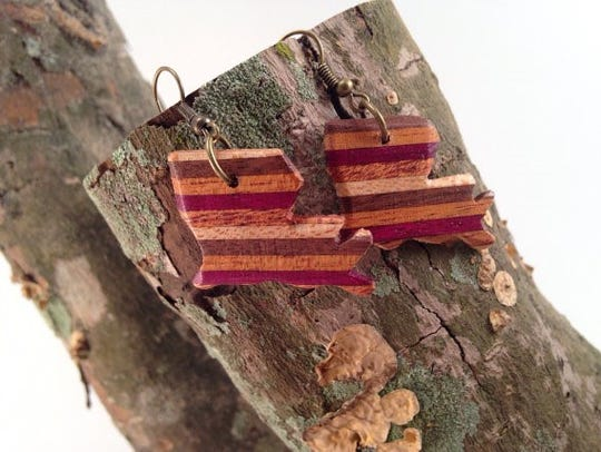 A pair of earrings made by hand.