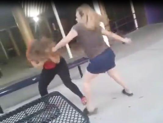 636438628908838827-Woman-seen-beating-student.jpg