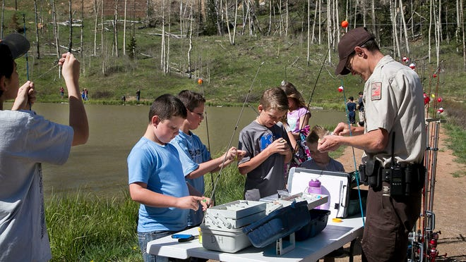 Department of Natural Resources and Division of Wildlife, partnered with Sportsmen for Fish and Wildlife on Saturday for a kids fishing workshop at Kids Ponds, located behind Woods Ranch.