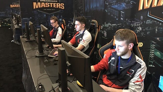 Esports team members playing video games