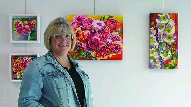 Maria Morris has her paintings on display at the 5.4.7 Arts Center in Greensburg. She hopes her art will encourage others who may have been through a traumatic experience to keep on going.