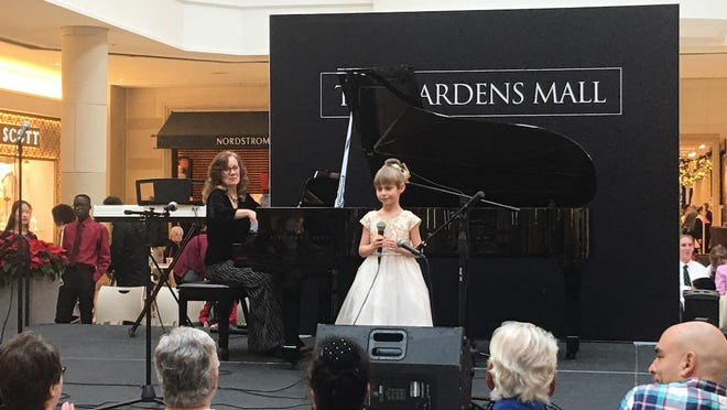 A young performer took the stage Dec. 21 at the 9th Annual MusicThon at The Gardens Mall. The event raised more than $10,000 to send South Florida children and families to a 2020 family bereavement camp offered through VITAS® Healthcare.