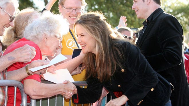 "Kelly Preston greets fans outside the Hollywood 16 Theater in Ocala on March 30, 2010, during the premiere of Preston's latest movie, ""The Last Song."""
