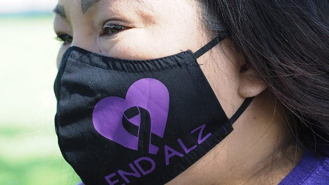 Denise Lee wears one of the masks she will be selling to raise funds for the upcoming the Stockton Walk to End Alzheimer's scheduled for Oct. 17.