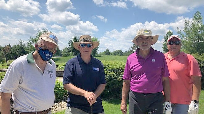 From left, David Dix, United Way of Portage County President and Chief Executive Officer Bill Childers, Frank Ciminio and Andy Drnjevic formed a United Way of Portage County team, which was sponsored by a donor to play in the outing. United Way funds were not used to pay for the outing.