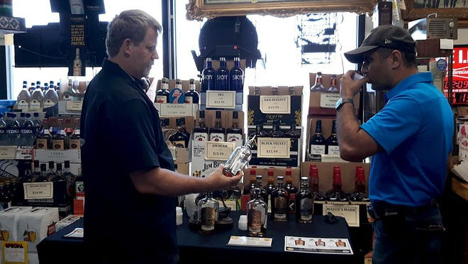 Horse Soldier Bourbon Whiskey co-founder and ex-Special Forces Capt. Mark Nustch talked with customers, let them sample bourbon and autographed product bottles Saturday at Comanche Beverage Outlet located on 1703 N 14th Ave.