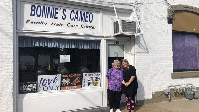Bonnie Becker and her daughter Andi Potter stand in front of Bonnie's Cameo hair salon, a business just off the Macomb downtown square. Becky is retiring after operating the salon for 37 years and Bonnie and Clyde's nightclub in Industry for 14 years.