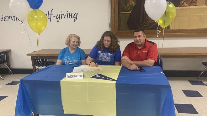 TMP senior Sasha Wasinger signs a letter of intent for track and field at Tabor College.
