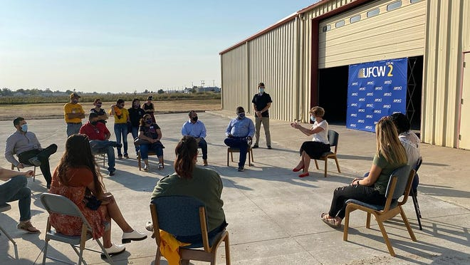 Members of the Latino community in Dodge City engage in discussion with Kansas Democratic U.S. Senate candidate Barbara Bollier at the UFCW District Union Local 2 community center.