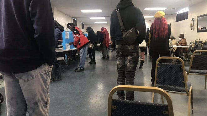 Voters in line at the polling precinct located at Fellowship of Love Community Church on Harmon Street.