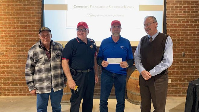 Avenue of Flags in Dodge City representatives David Grasser, Charles Sellens and Allen Burkhart received a grant of $3,000 from Pat Hamit of the Community Foundation of Southwest Kansas.