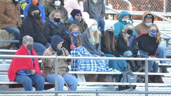 Inland Lakes fans watch a varsity football game against Charleton Heston Academy in September. Limited numbers of spectators will be allowed for the final rounds of the Michigan High School Athletic Association Football and Girls Volleyball Tournaments, per approval received today from the Michigan Department of Health and Human Services (MDHHS).