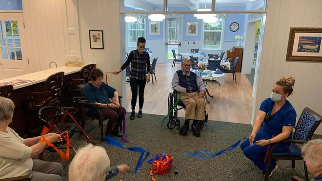 Residents and staff and Pineview Cottage in Harbor Springs take part in a mind and body exercise at the assisted living and memory care facility located on M-119. Owner Hilde Bonesteel said thinking outside the box to incorporate different activities which bring smiles to faces has been key since the novel coronavirus pandemic began in March.