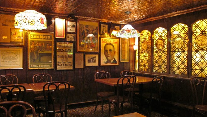 The street-level pub and restaurant is a mix of stained glass and tin ceilings.