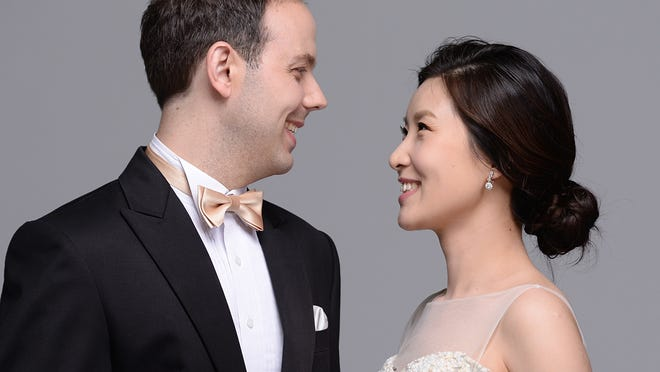 """Pianists Adam Clark, left, and Eunbyol Ko will perform Mozart's """"Piano Concerto No. 10 in E flat"""" Sunday, Nov. 9, in MTSU's Hinton Music Hall as part of the Middle Tennessee Choral Society's presentation of Haydn's """"Creation."""" The couple are members of the MTSU School of Music faculty."""