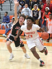 Mansfield Senior's DaQuan Hilory dribbles the ball in front of Mount Vernon's Cole Rapp on Friday evening.