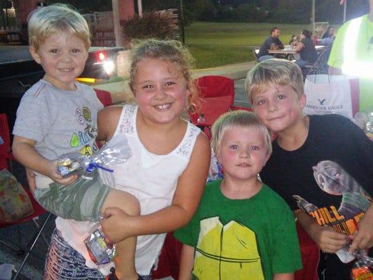 Cousins (l-r) Reese Sharp, Laynee Stinson, Ben Redden and Dylan Redden enjoy EMS Nite Lites at the Fairview Recreation Complex September 16, 2017.
