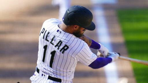 Colorado Rockies' Kevin Pillar connects for a triple to drive in two runs off San Francisco Giants relief pitcher Tyler Rogers in the seventh inning on Wednesday at Coors Field in Denver.