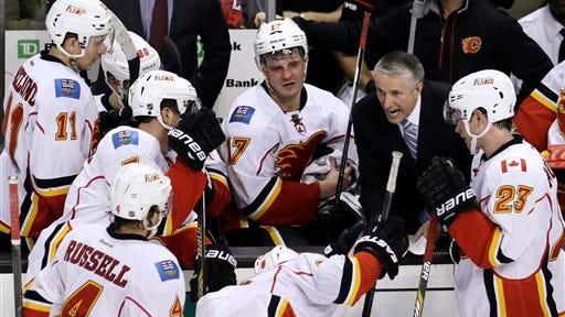 Calgary Flames head coach Bob Hartley sets a play during overtime of an NHL hockey game. (AP Photo/Charles Krupa)