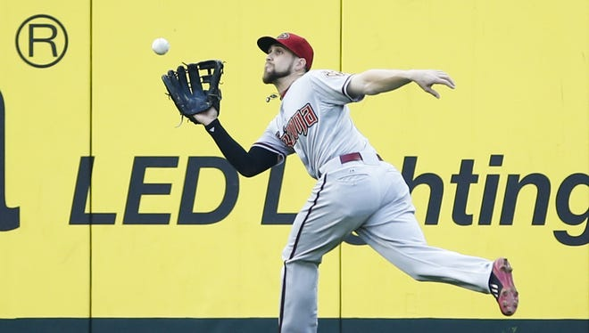 Diamondbacks left fielder Ender Inciarte (5) catches a line drive for the final out of the first inning against the Seattle Mariners at Safeco Field last season.