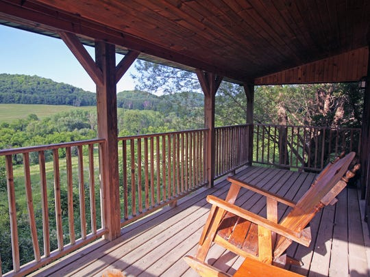 Porches at the Kickapoo Valley Ranch near La Farge feature large rocking chairs and views of the surrounding hills.