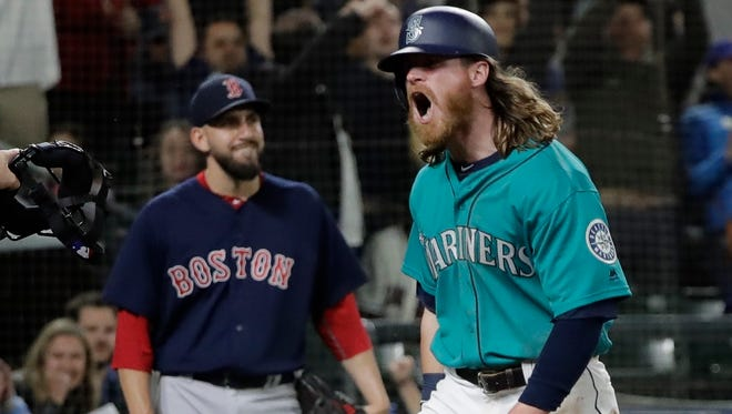 Ben Gamel celebrates after scoring a run against the Red Sox on June 15 in Seattle. The acquisition of Denard Span in May cut into Gamel's playing time, but since then he has been the team's best outfielder.
