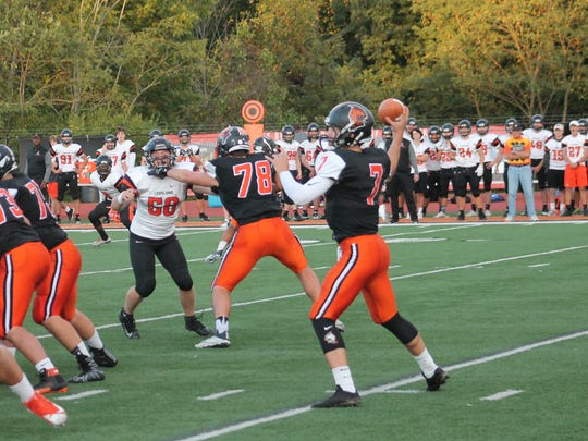 Anderson quarterback Jay Volpenhein drops back to hit a teammate against Loveland Sept. 29.