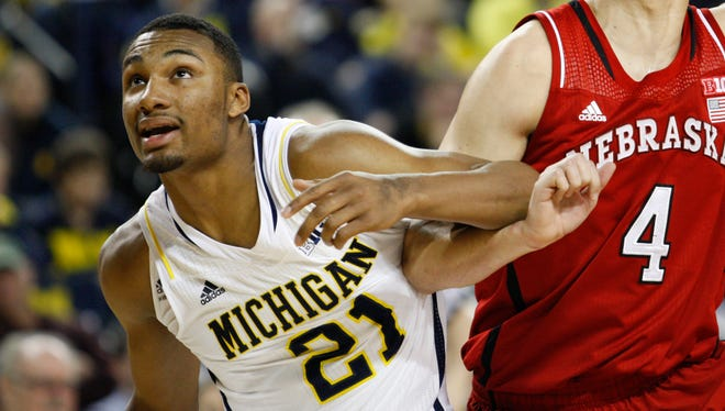 Michigan Wolverines guard Zak Irvin and Nebraska Cornhuskers guard Nathan Hawkins fight for position during the second half at Crisler Arena.