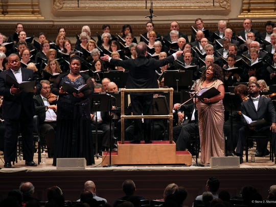 Spring For Music Festival, from left, Baritone Donnie Ray Albert, mezzo-soprano Ronnita Nicole Miller, conductor James Conlon, soprano Latonia Moore, and tenor Rodrick Dixon (seated) with the Cincinnati Symphony Orchestra and May Festival Chorus, Carnegie Hall.