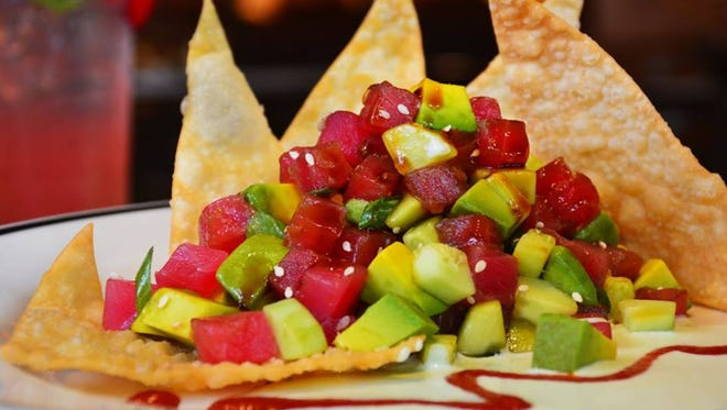 Blackfinn Ameripub serves burgers, chicken, fish, specialty drinks and more.