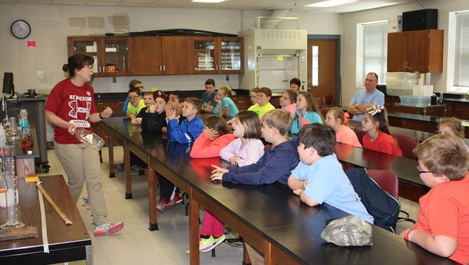 HCC professor Kara Becker spoke to SES students about the power of chemistry during their visit.