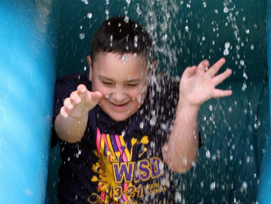 Children were drenched on the water slide during Saturday's