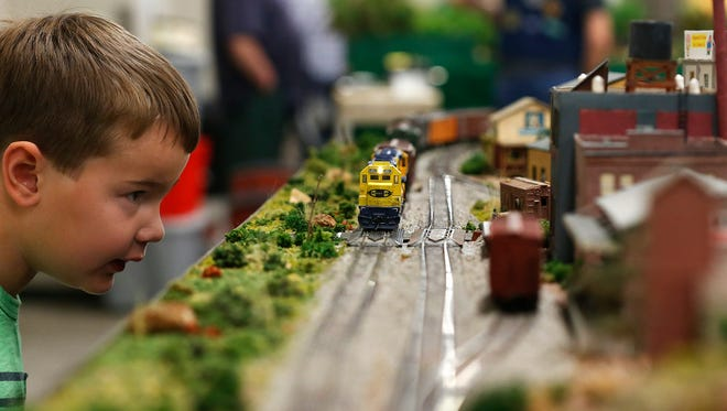 Micah Perry, 5, watches a miniature train roll through a layout during the Ozarks Model Railroad Association 38th Annual Spring Train Show held at the Springfield Expo Center in Springfield, Mo. on April 16, 2016.