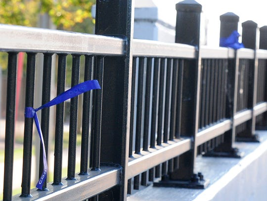 Blue ribbons decorate the Johnson Street bridge Sept.